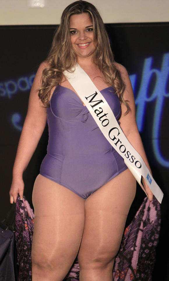 Contestant Mirna Tardim, from Brazil's Mato Grosso state, performs during the Miss Brazil Plus Size Beauty Pageant in Sao Paulo, Brazil, Sunday, Jan. 29, 2012. A growing number of bikini and swimming suits manufacturers have woken up to Brazil's thickening waistline and are reaching out to the ever-expanding ranks of heavy women with new plus-size lines. (AP Photo/Andre Penner)