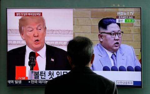 """President Donald Trump is expected to demand that Pyongyang abolish its nuclear weapons capability within a year when he sits down for talks with Kim Jong-un, the North Korean dictator, but will offer to open an embassy in the North's capital and provide humanitarian assistance as an incentive. The details offer a sense of the rapid pace of progress towards talks although analysts suggest the timetable may be overambitious. Quoting sources in Washington, South Korea's Chosun Ilbo newspaper said Mr Trump rejected Pyongyang's proposals for """"phased and synchronised"""" steps to eliminate the North's nuclear arsenal and will instead insist that full denuclearisation is completed within 12 months of their meeting. Donald Trump and Kim Jong-un appear on a TV screen at Seoul Railway Station Credit: AP The Dong-A Ilbo newspaper added that North Korea and the US have already started discussing an outline of the agenda for when their two leaders meet - Mr Trump has suggested the summit is likely to take place in May or early June - and that Washington is willing to """"compensate"""" Pyongyang by boosting the regime's standing by opening a liaison office and an embassy, as well as delivering humanitarian aid. Analysts, however, say the time frame is """"unrealistic"""". Donald Trump surprised the world when he agreed to meet Kim Jong-un Credit: Getty Images Daniel Pinkston, a professor of international relations at the Seoul campus of Troy University, said: """"Complete denuclearisation will mean the North declaring all its nuclear facilities and programmes - military and civilian - and then having independent inspectors draw up inventories of everything they have. """"Exports will need to be accounted for, nuclear cooperation deals will need to be examined - such as for the nuclear reactor agreement with Syria - and there will then need to be full dismantling of all facilities in accordance with [International Atomic Energy Agency] guidelines."""" Verification would add another level of complexity."""