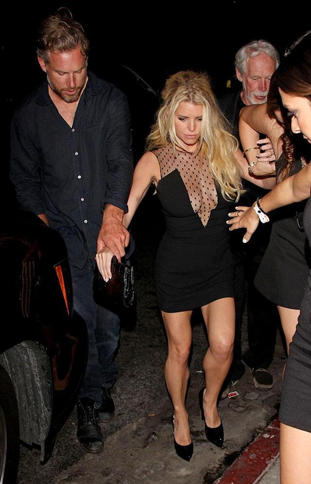 Jessica Simpson looks a bit worse for wear as she is helped out of Warwick nightclub by Eric Johnson in June 2014. (Photo: Pacific Coast News)