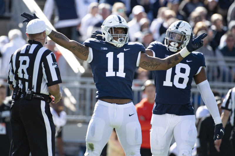 Penn State linebacker Micah Parsons (11) and defensive end Shaka Toney (18) celebrate a sack of Purdue quarterback Jack Plummer (13) in the second half of an NCAA college football game against Purdue in State College, Pa., on Saturday, Oct. 5, 2019. Penn State defeated Purdue 35-7. (AP Photo/Barry Reeger)