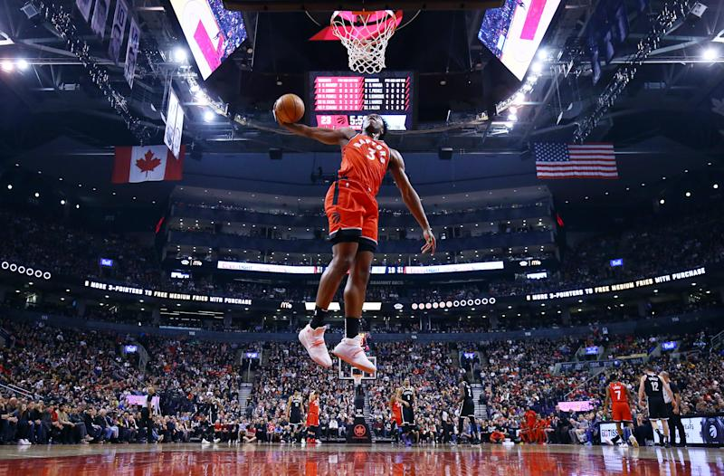 OG Anunoby #3 of the Toronto Raptors attempts a dunk after a stoppage in play.