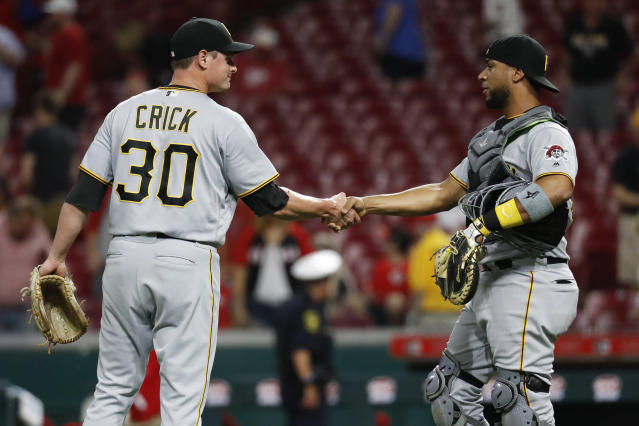 Pittsburgh Pirates relief pitcher Kyle Crick (30) and catcher Elias Diaz, right, celebrate after the team's baseball game against the Cincinnati Reds, Wednesday, May 23, 2018, in Cincinnati. The Pirates won 5-4 in 12 innings. (AP Photo/John Minchillo)