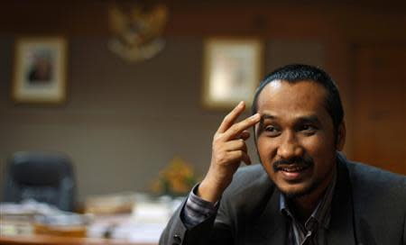 KPK chief Samad gestures during an interview at his officec in Jakarta