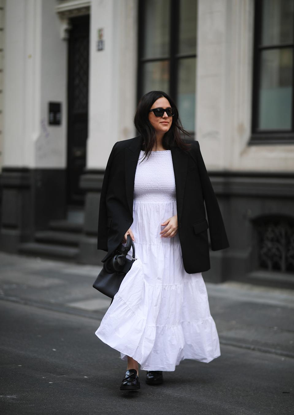 """Whether adorned with puffed sleeves or smocked details, the billowing <a href=""""https://www.glamour.com/gallery/things-to-buy-through-glamour-rewards?mbid=synd_yahoo_rss"""" rel=""""nofollow noopener"""" target=""""_blank"""" data-ylk=""""slk:house dress"""" class=""""link rapid-noclick-resp"""">house dress</a> is what you put on when you're feeling playful and fancy...but also ready to sprawl out on the couch with a plate of <a href=""""https://www.glamour.com/story/nuggs-review?mbid=synd_yahoo_rss"""" rel=""""nofollow noopener"""" target=""""_blank"""" data-ylk=""""slk:chicken nuggets"""" class=""""link rapid-noclick-resp"""">chicken nuggets</a>. They're another welcome trend to come out of our comfort-first lifestyle—and look great with <a href=""""https://www.glamour.com/gallery/best-summer-sandals?mbid=synd_yahoo_rss"""" rel=""""nofollow noopener"""" target=""""_blank"""" data-ylk=""""slk:strappy sandals"""" class=""""link rapid-noclick-resp"""">strappy sandals</a> or dressed up with a blazer and statement footwear for the office."""