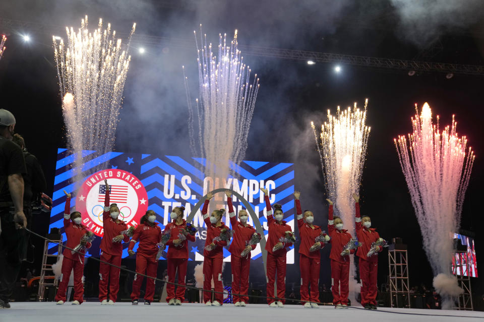 Members of the US Women's Olympic Gymnastic Team and alternates celebrate after the women's U.S. Olympic Gymnastics Trials Sunday, June 27, 2021, in St. Louis. (AP Photo/Jeff Roberson)