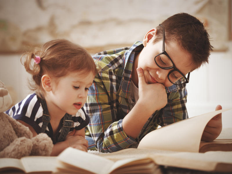 Older Sibling Reading with Younger Sibling