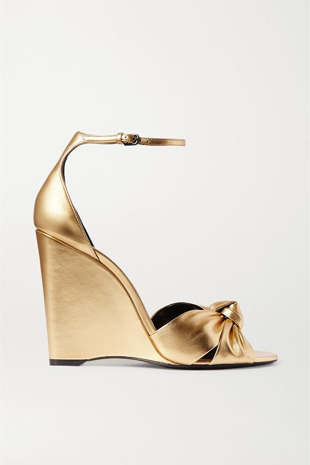 """<p><strong>SAINT LAURENT</strong></p><p>net-a-porter.com</p><p><strong>$945.00</strong></p><p><a href=""""https://go.redirectingat.com?id=74968X1596630&url=https%3A%2F%2Fwww.net-a-porter.com%2Fus%2Fen%2Fproduct%2F1210479&sref=https%3A%2F%2Fwww.harpersbazaar.com%2Fwedding%2Fbridal-fashion%2Fg31223808%2Fbest-beach-wedding-shoes%2F"""" target=""""_blank"""">SHOP NOW</a></p><p>For the fashion lovers who wear shoes at daring heights year-round, go sky-high, but with a wedge. Low-rise wedges can look a little matronly, but the super-high versions feel just as sexy as your best stiletto.</p>"""