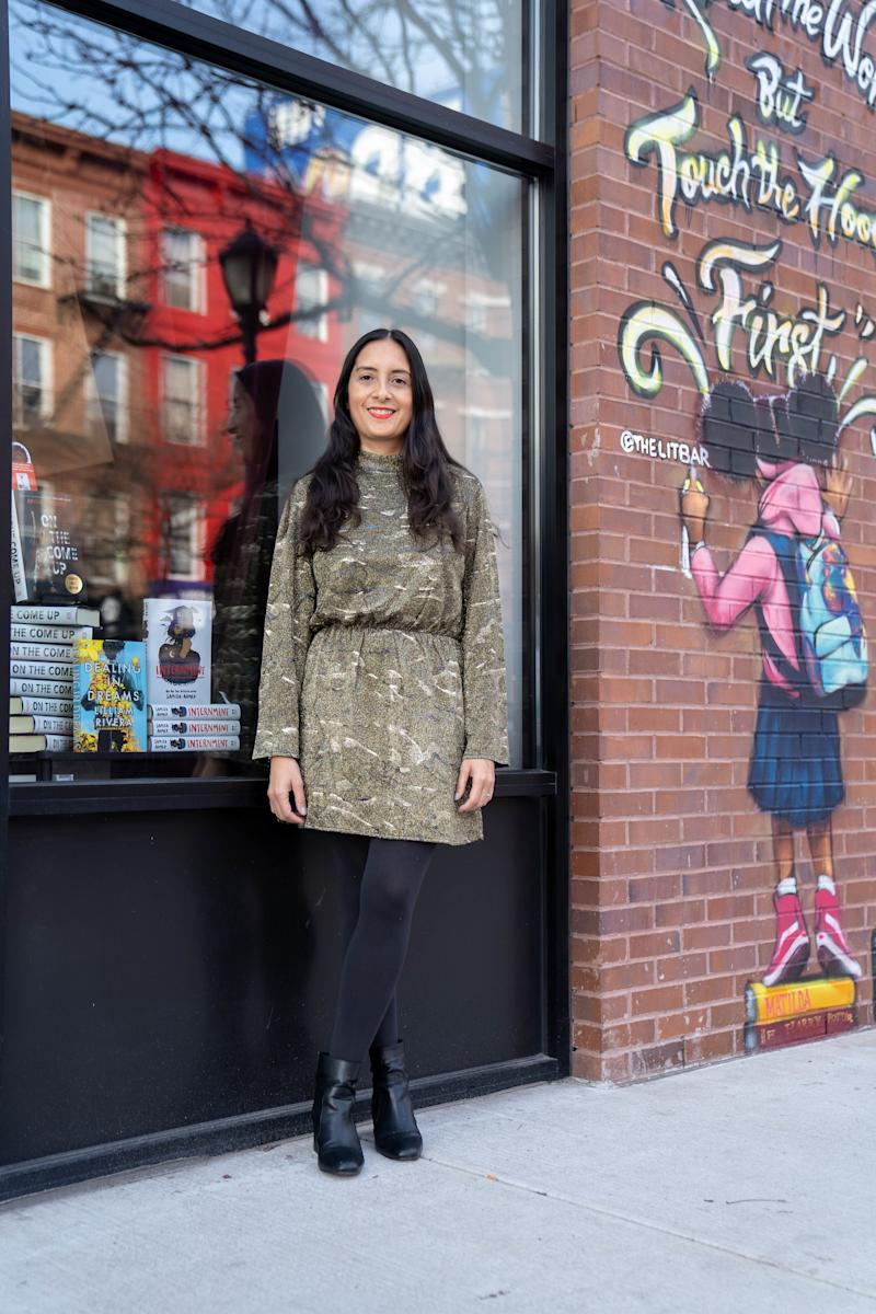 Author Lilliam Rivera in front of the Bronx's Lit Bar.