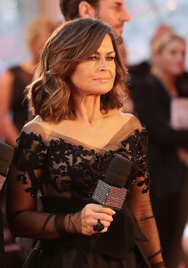 Lisa, pictured here on the Logie Awards red carpet which she hosted alongside Karl, announced her shock departure on Monday night. Source: Getty