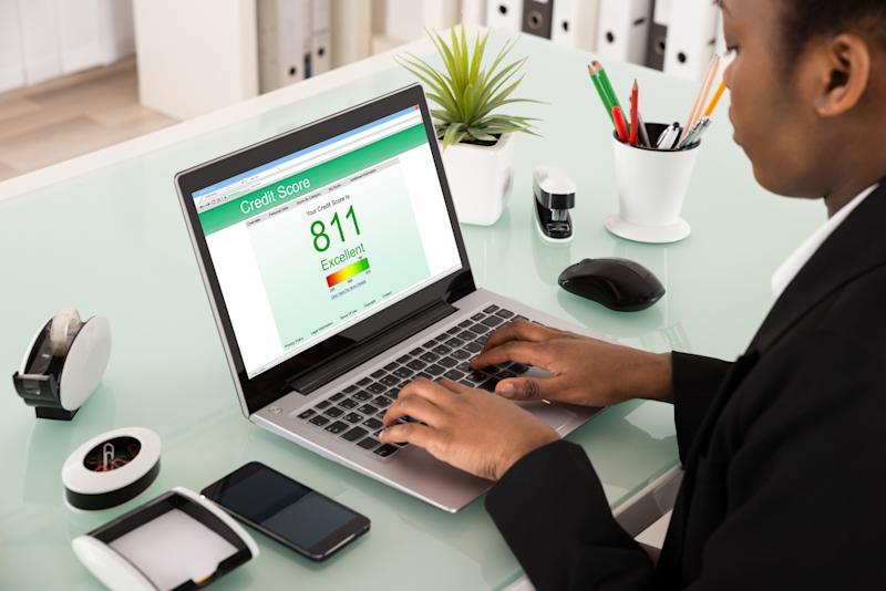 Man Using Laptop To View His Excellent Credit Score Of 811