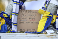 Close up of a banner as fans protest outside Elland Road against Liverpool's decision to be included amongst the clubs attempting to form a new European Super League, in Leeds, England, Monday, April 19, 2021. Reaction to the proposals from 12 clubs to rip up European soccer by forming a breakaway Super League has ranged from anger and condemnation to humor and sarcasm. (Zac Goodwin/PA via AP)