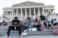 Supporters of Rep. Cori Bush, D-Mo., camp with her outside the U.S. Capitol, in Washington, Monday, Aug. 2, 2021, as anger and frustration has mounted in Congress after a nationwide eviction moratorium expired at midnight Saturday. (AP Photo/Jose Luis Magana)