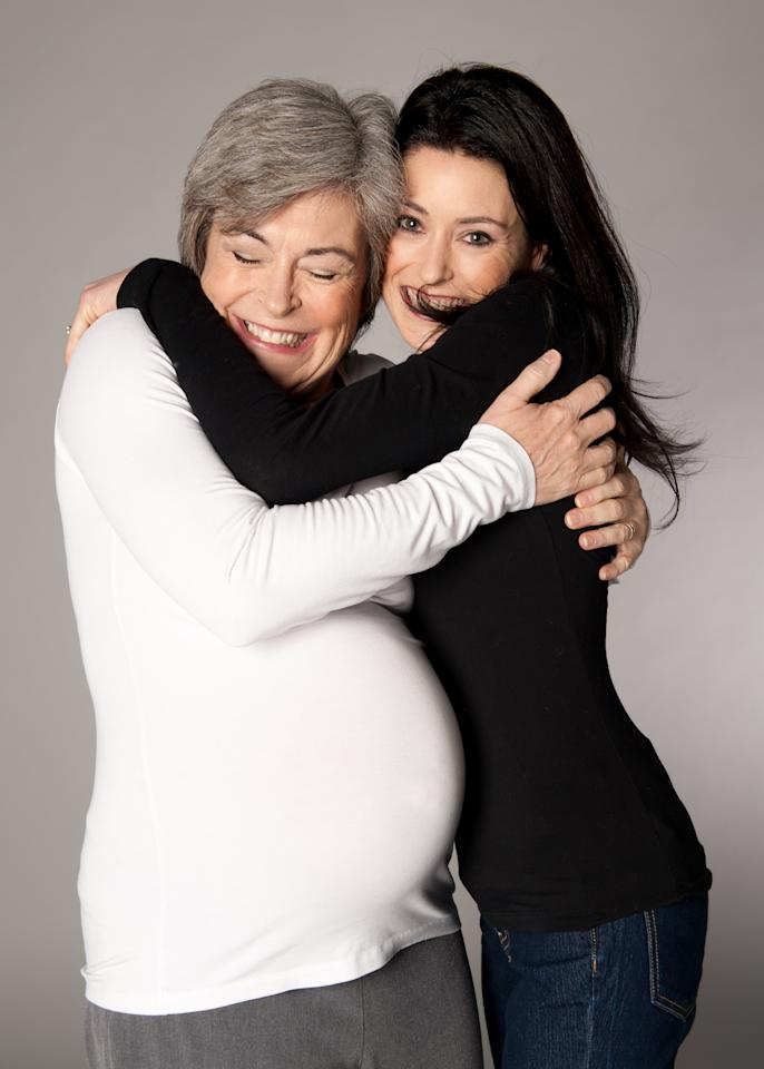 Sara and Kris pose during her pregnancy. Credit: Mary Rafferty Photography.