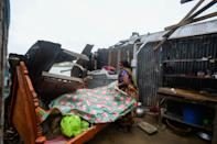A woman salvages items from her house damaged by cyclone Amphan in Satkhira on May 21, 2020. (Photo by MUNIR UZ ZAMAN/AFP via Getty Images)