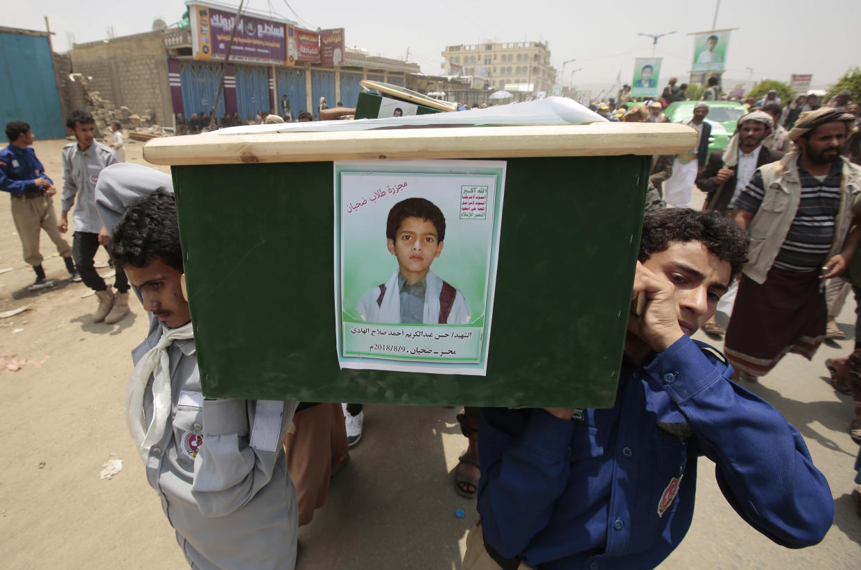 Yemenis carry the coffin of a boy who was killed in a Saudi-led airstrike, Saana, Yemen, August 2018. (Photo: Hani Mohammed/AP)