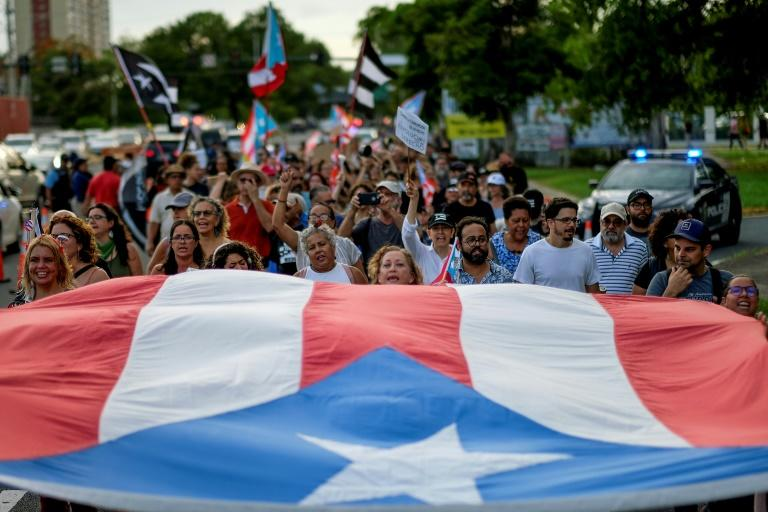 Protesters march in San Juan, Puerto Rico in July 2018 (AFP Photo/Ricardo ARDUENGO)