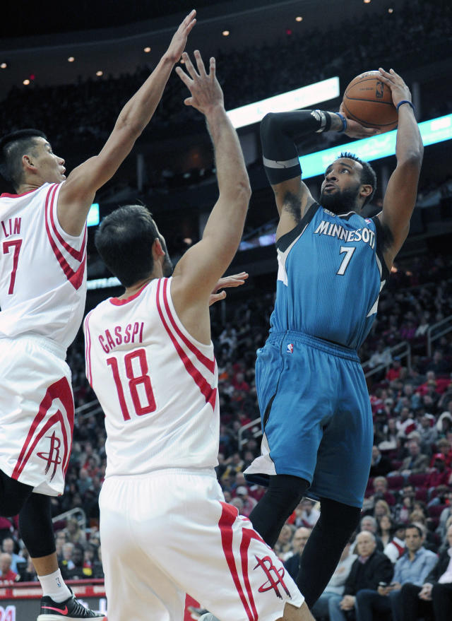Minnesota Timberwolves' Derrick Williams (7), right, shoots over Houston Rockets Jeremy Lin (7) and Omri Casspi (18) in the first half of an NBA basketball game Saturday, Nov. 23, 2013, in Houston. (AP Photo/Pat Sullivan)