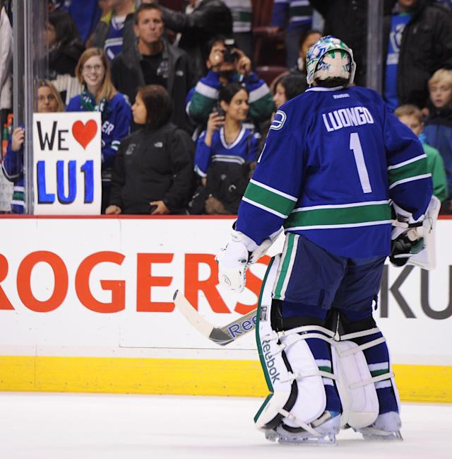 VANCOUVER, CANADA - DECEMBER 1: A fan shows her support for Roberto Luongo #1 of the Vancouver Canucks during warm-ups before the game against the Nashville Predators at Rogers Arena on December 1, 2011 in Vancouver, British Columbia, Canada. (Photo by Derek Leung/Getty Images)