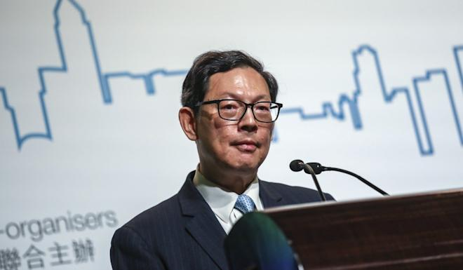 Norman Chan Tak-lam, former chief executive of Hong Kong Monetary Authority, said holders of the Tracker Fund since the IPO will have made annualised returns of 7.6 per cent. Photo: Jonathan Wong