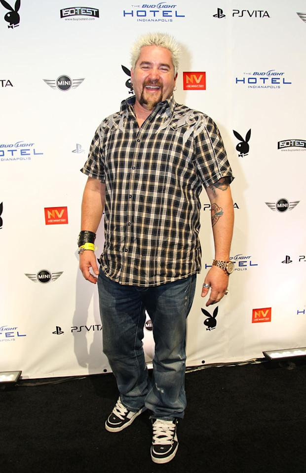 Celebrity chef Guy Fieri arrives at the Playboy Party at the Bud Light Hotel in Indianapolis.