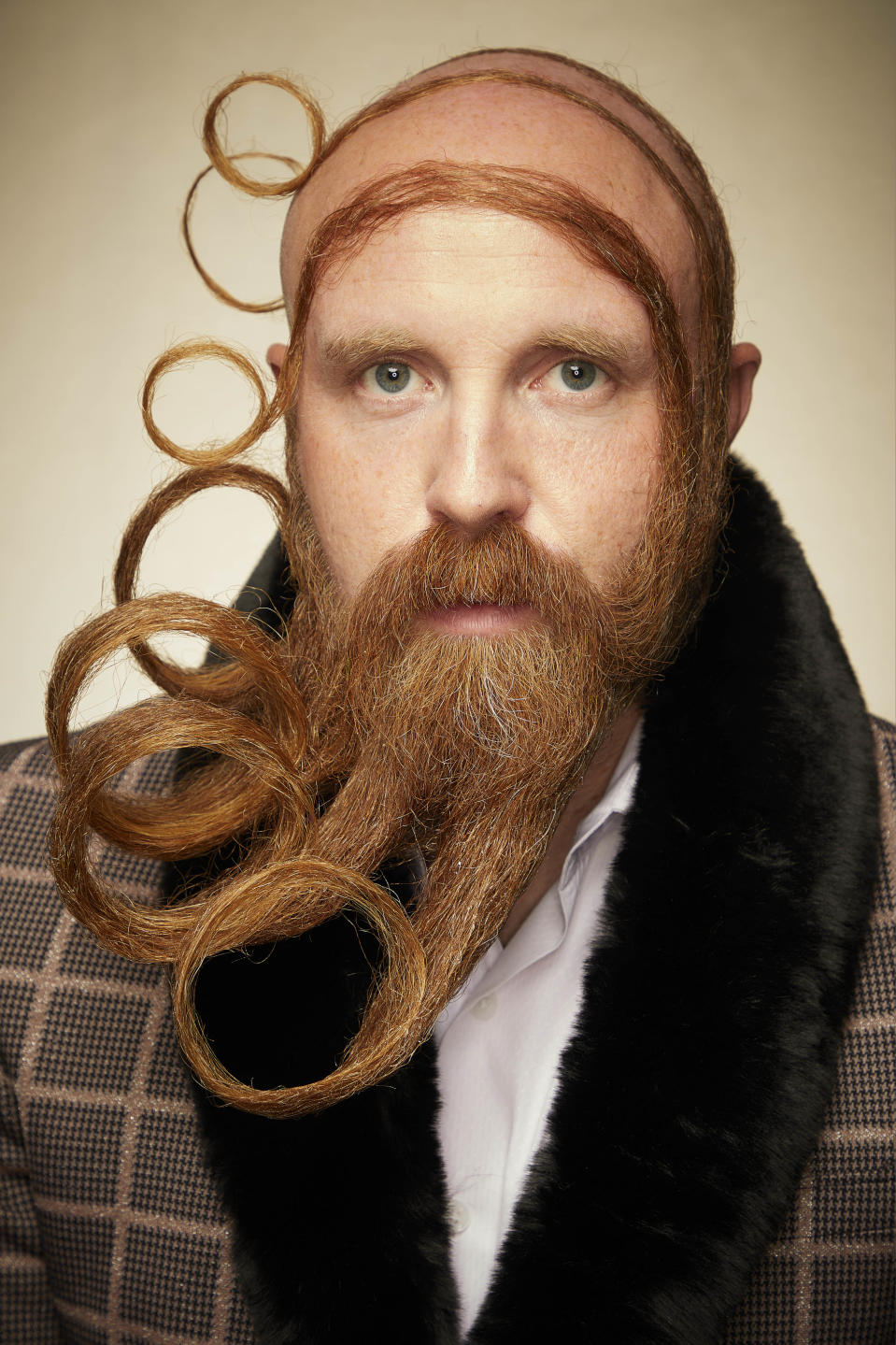 We're going dizzy with this beard styled in concentric circles. [Photo: Caters]