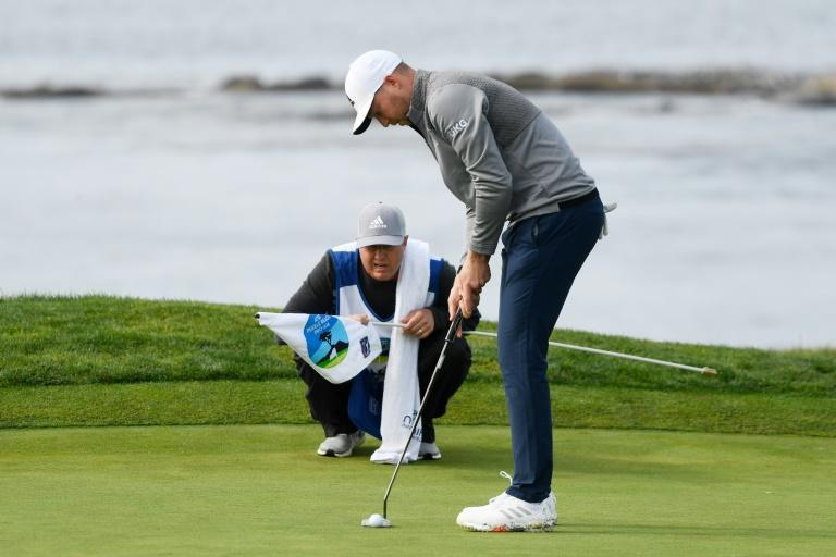 American Daniel Berger putts for eagle after driving the green at the fourth hole in the third round of the US PGA Tour Pebble Beach Pro-Am