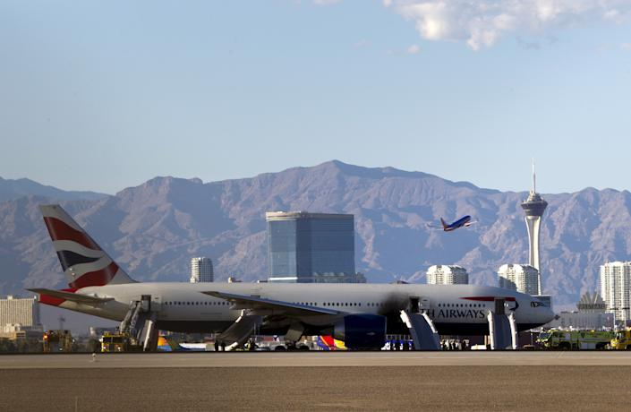 A British Airways passenger jet is shown after a fire at McCarran International Airport in Las Vegas September 8, 2015. The plane caught fire after an aborted takeoff on Tuesday, but the flames were extinguished and just two people among the 159 passengers and 13 crew onboard suffered minor injuries, McCarran International Airport said on Twitter. REUTERS/Steve Marcus      TPX IMAGES OF THE DAY