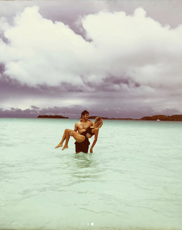 "<p>""The sun outsmarted rainy season this afternoon and lit the ocean up like a neon sign,"" the newlywed gushed as she posed in the waters of Bora Bora with her husband, Morgan Evans. ""Soaking up our last day in this heavenly place."" (Photo: <a href=""https://www.instagram.com/p/BdrIWIZl6HD/?taken-by=kelseaballerini"" rel=""nofollow noopener"" target=""_blank"" data-ylk=""slk:Kelsea Ballerini via Instagram"" class=""link rapid-noclick-resp"">Kelsea Ballerini via Instagram</a>) </p>"