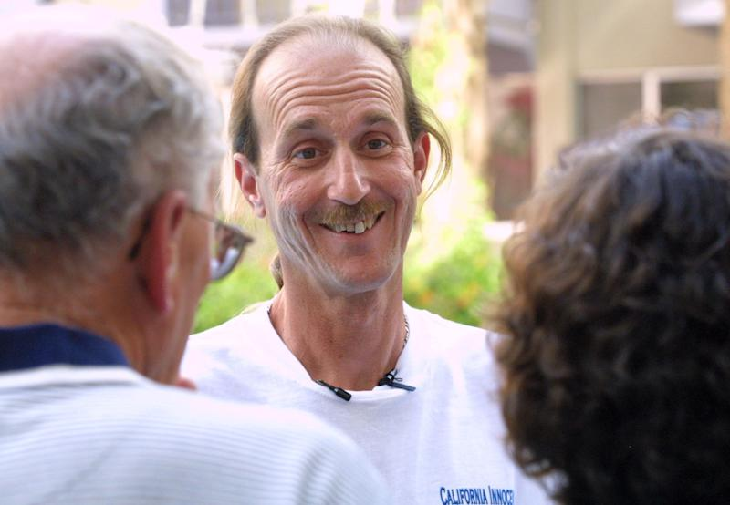 FILE-In this Wednesday, April 10, 2002 file photo Ray Krone, center, smiles at his mother Carolyn, right and stepfather, Jim Leming, after they drove from Dover, Pa., to Phoenix, to see Krone following his release from Arizona's Florence Prison. Since 2000, at least 18 men convicted in rapes and murders largely because of bite-mark analysis have been exonerated by DNA testing or otherwise proved not guilty. (AP Photo/East Valley Tribune, Darryl Webb, File)