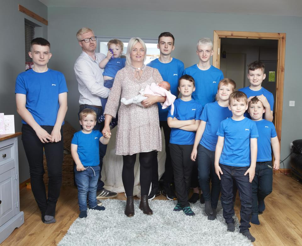 Alexis and David Brett photographed alongside their 10 sons and newborn daughter, Cameron [Photo: Caters]
