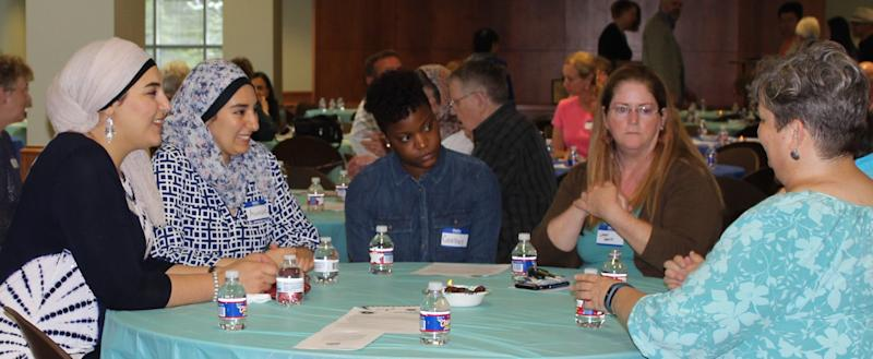 Community members at an interfaith iftar organized by Crescent Peace Society in June.
