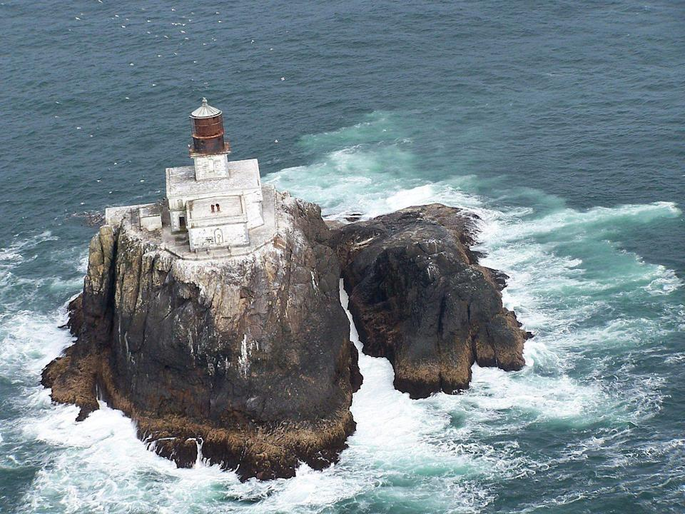 """<p><strong>Tillamook Rock Lighthouse - OR</strong></p><p>An enigma surrounds the abandoned lighthouse known as """"Terrible Tilly."""" Because of the lighthouse's isolated location and the violent waters that surround it, the building was difficult to access. It ran as a working lighthouse <a href=""""https://traveloregon.com/things-to-do/culture-history/historic-sites-oregon-trail/the-mystery-of-terrible-tilly/"""" rel=""""nofollow noopener"""" target=""""_blank"""" data-ylk=""""slk:for over 70 years,"""" class=""""link rapid-noclick-resp"""">for over 70 years,</a> before turning down in 1957. Today, it sits atop the rock, surrounded by a sea of lore.</p><p>Photo: Wikimedia Commons/<a href=""""https://en.wikipedia.org/wiki/Tillamook_Rock_Light#/media/File:USCG_Tillamook_Rock_Lighthouse.jpg"""" rel=""""nofollow noopener"""" target=""""_blank"""" data-ylk=""""slk:United States Coast Guard"""" class=""""link rapid-noclick-resp"""">United States Coast Guard</a></p>"""