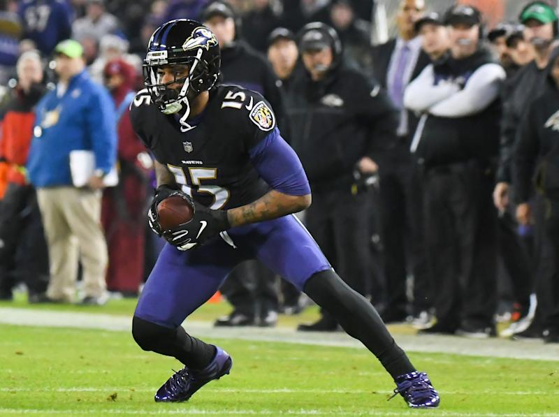 BALTIMORE, MD - DECEMBER 30, 2018: Wide receiver Michael Crabtree #15 of the Baltimore Ravens carries the ball in the second quarter of a game against the Cleveland Browns on December 30, 2018 at M&T Bank Stadium in Baltimore, Maryland. Baltimore won 26-24. (Photo by: 2018 Nick Cammett/Diamond Images/Getty Images)