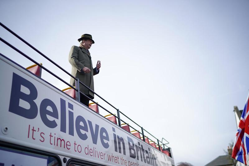 Former UKIP leader Nigel Farage addresses marchers from the top of a bus (Getty Images)