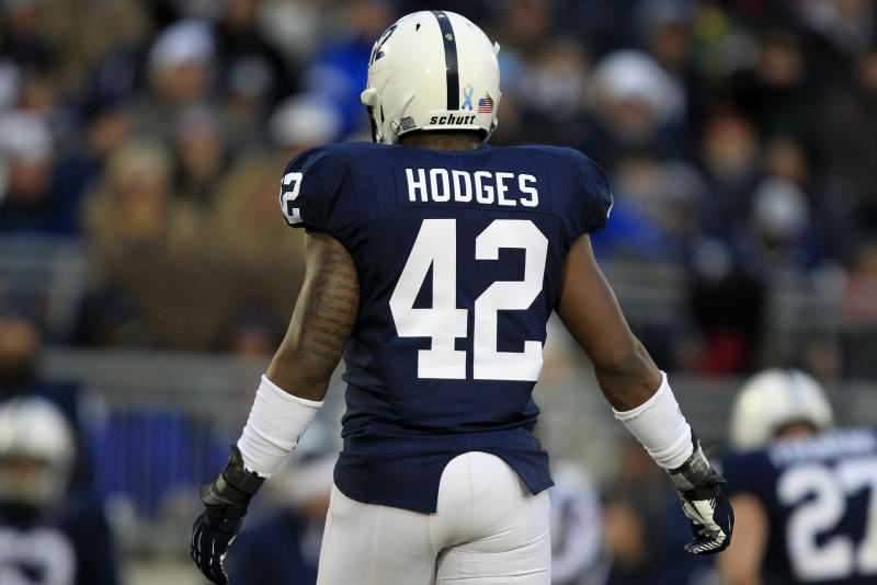 Penn State linebacker Gerald Hodges wears injured teammate Penn State linebacker Michael Mauti's jersey No. 42 during an NCAA college football game against Wisconsin in State College, Pa., Saturday, Nov. 24, 2012. (AP Photo/Gene J. Puskar)