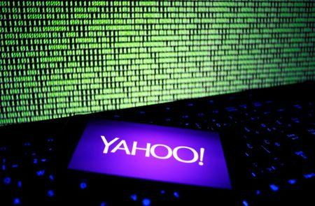 A photo illustration shows a Yahoo logo on a smartphone in front of a displayed cyber code and keyboard on December 15, 2016. REUTERS/Dado Ruvic/Illustration