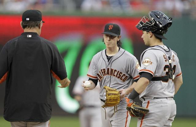 San Francisco Giants manager Bruce Bochy, left, removes pitcher Tim Lincecum, center, from a baseball game against the Washington Nationals during the third inning as Giants catcher Andrew Susac, right, stands by on Saturday, Aug. 23, 2014, in Washington. The Nationals won 6-2. (AP Photo/Luis M. Alvarez)