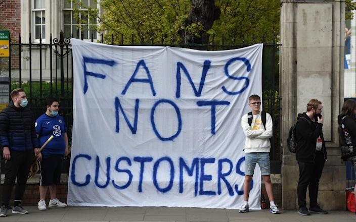 Chelsea fans protest against the newly proposed European Super League - EDDIE MULHOLLAND FOR THE TELEGRAPH