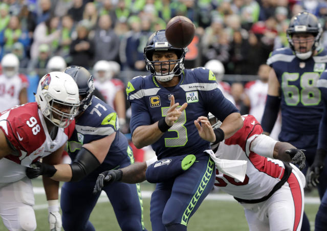 Seattle Seahawks quarterback Russell Wilson (3) passes against the Arizona Cardinals during the first half of an NFL football game, Sunday, Dec. 30, 2018, in Seattle. (AP Photo/Ted S. Warren)
