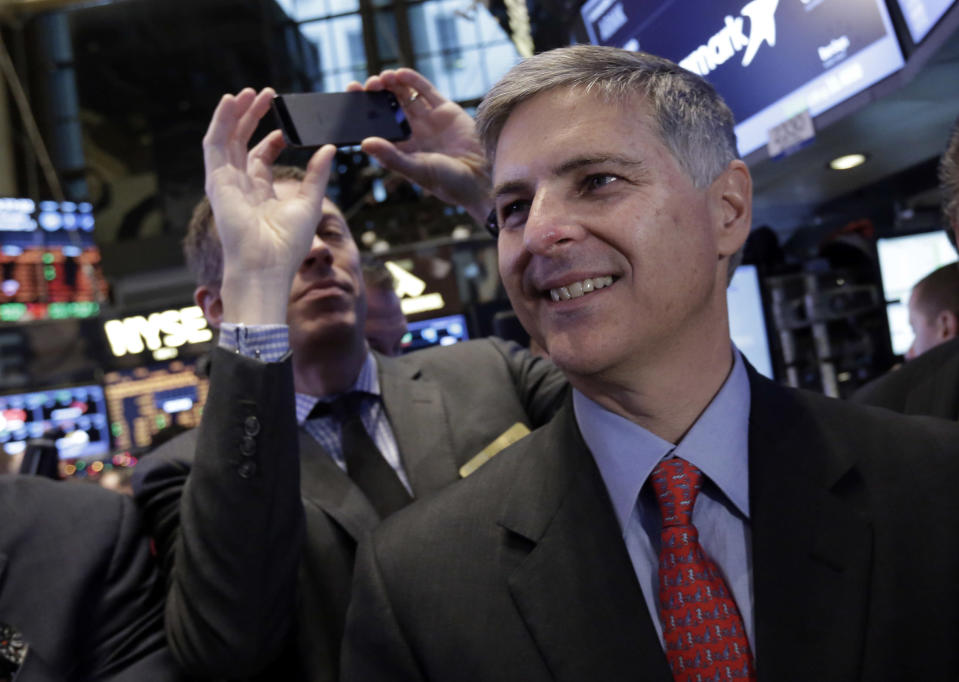 CEO of Hilton Worldwide Christopher Nassetta, right, waits for his company's IPO to begin trading on the floor of the New York Stock Exchange, Thursday, Dec. 12, 2013. Hilton Worldwide Holdings Inc. is the world's largest hotel group, with 665,667 rooms across 90 countries and territories. (AP Photo/Richard Drew)