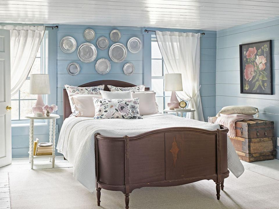 """<p>You might be tempted to go with a crisp white in a cramped bedroom. You could do that. Or you could envelop the walls with a dreamy <a href=""""https://www.benjaminmoore.com/en-us/color-overview/find-your-color/color/hc-145/van-courtland-blue?color=HC-145"""" rel=""""nofollow noopener"""" target=""""_blank"""" data-ylk=""""slk:Van Courtland Blue by Benjamin Moore"""" class=""""link rapid-noclick-resp"""">Van Courtland Blue by Benjamin Moore</a> and wake up every morning in a very good mood. The choice is yours. </p>"""