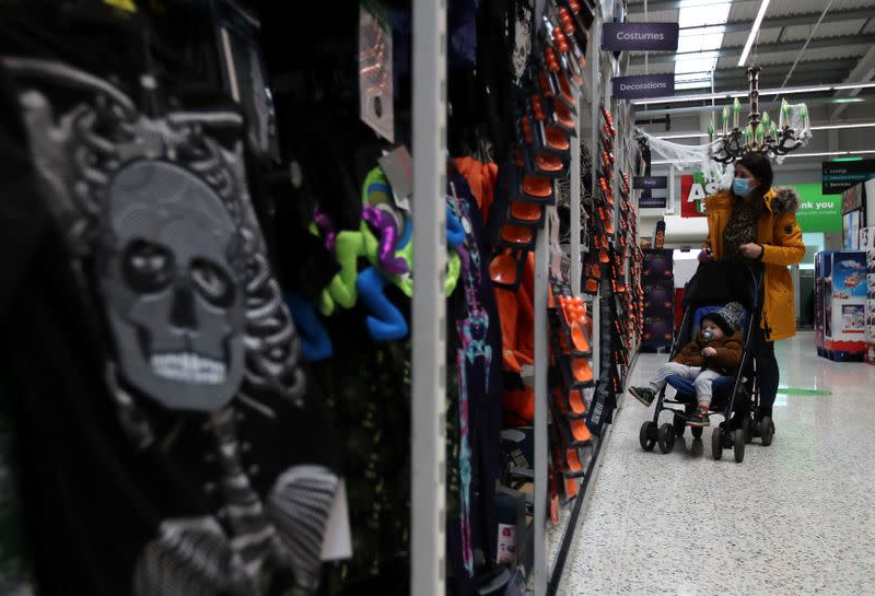 A customer looks at the Halloween costumes in the UK supermarket Asda, as the store launches a new sustainability strategy, in Leeds