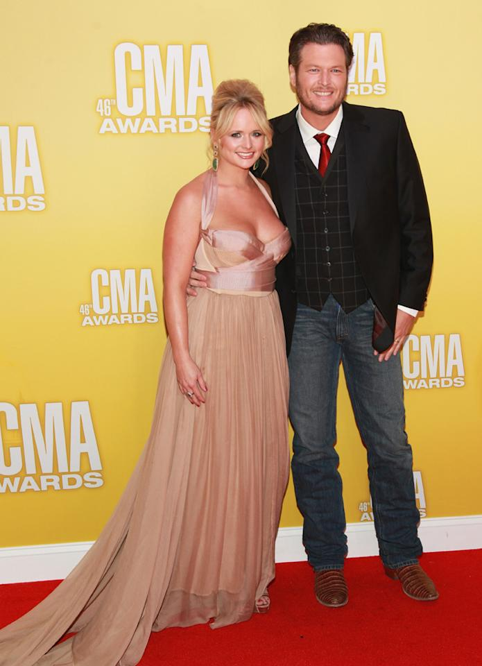 "<p class=""MsoNormal""><span style=""color:black;"">Country couple Blake Shelton and Miranda Lambert – who are both nominated for CMAs – looked like they were attending two different events. While the ""Voice"" coach stuck with his usual jeans and cowboy boots (and a plaid vest), his wife stunned in a blush-colored halter gown. The custom-made creation ""is so awesome and I know it will be in a museum one day so I have to be careful with it,"" she told <i>People</i>. ""It's the most awesome thing I'm ever going to wear. I love it because it's very personal to me — it has a lot of meaning for me."" (11/1/2012)</span></p>"