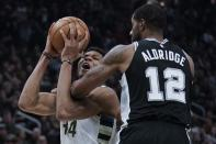 Milwaukee Bucks' Giannis Antetokounmpo is fouled by San Antonio Spurs' LaMarcus Aldridge during the first half of an NBA basketball game Saturday, Jan. 4, 2020, in Milwaukee. (AP Photo/Morry Gash)