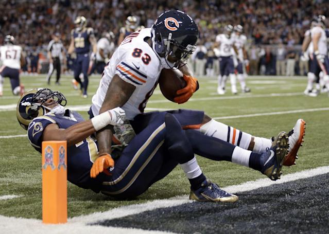 Chicago Bears tight end Martellus Bennett (83) crosses into the end zone after catching a 7-yard touchdown pass as St. Louis Rams safety T.J. McDonald defends during the first quarter of an NFL football game on Sunday, Nov. 24, 2013, in St. Louis. (AP Photo/Nam Y. Huh)