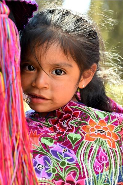 A young girl attends a mass celebrated by Pope Francis with representatives of the indigenous communities of Chiapas in the municipal sport center in San Cristobal de Las Casas, Chiapas, Mexico on February 15, 2016