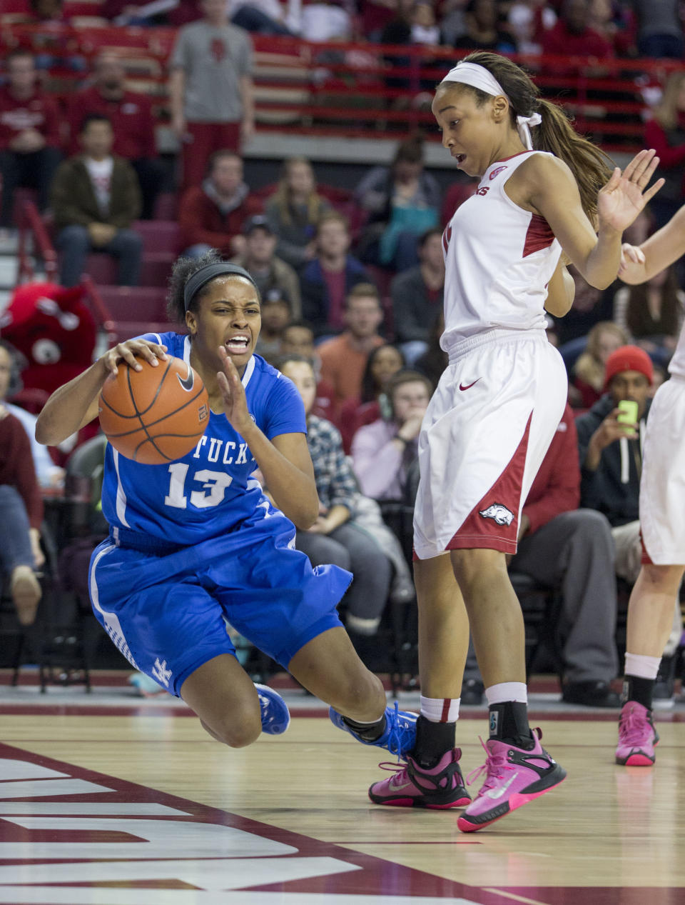 Kentucky guard Bria Goss, left, falls after running into Arkansas guard Kelsey Brooks, right, during the second half of an NCAA college basketball game Thursday, Feb. 26, 2015, in Fayetteville, Ark. Kentucky defeated Arkansas 56-51. (AP Photo/Gareth Patterson)