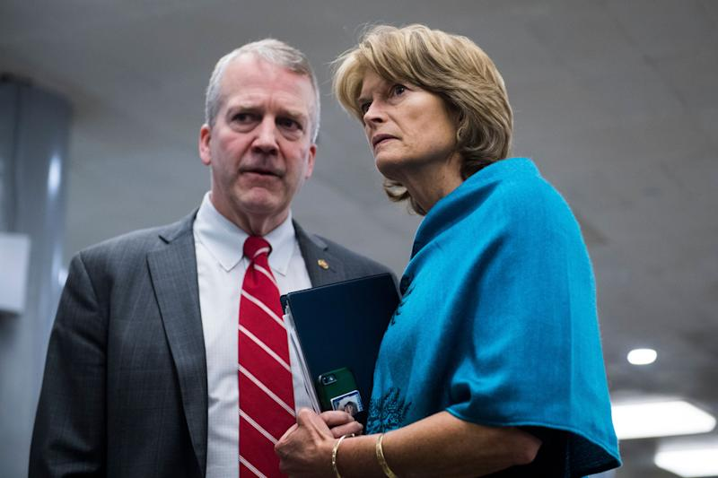 Sens. Dan Sullivan and Lisa Murkowski, Alaska Republicans, consult on Capitol Hill. Murkowski has a more moderate record, including a key vote against repealing Obamacare. (Photo: Tom Williams/CQ Roll Call/Getty Images)