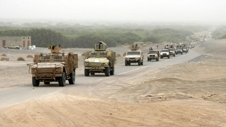 An armoured convoy of Yemeni pro-government fighters arrives in Al-Durayhimi district, south of Hodeida, on June 13, 2018, at the start of an Emirati-backed campaign to retake the strategic Red Sea port city from Huthi rebels