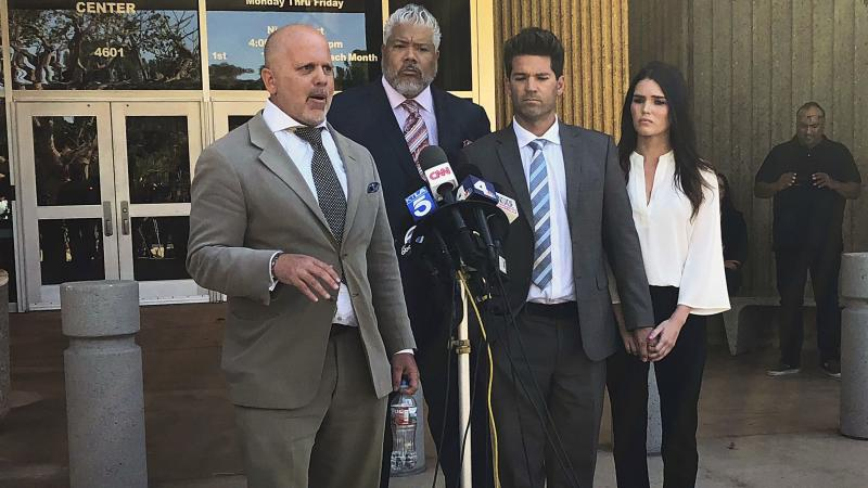 Reality show doctor Grant Robicheaux, second from right, and his girlfriend Cerissa Riley, right, listen as Robicheaux's attorney speaks.  (Yahoo Magazines PYC)